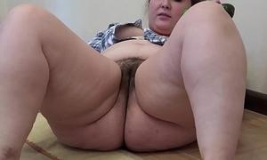 A fat skirt yon a queasy pussy masturbates yon a cucumber
