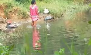 Aunty bathing outdoors
